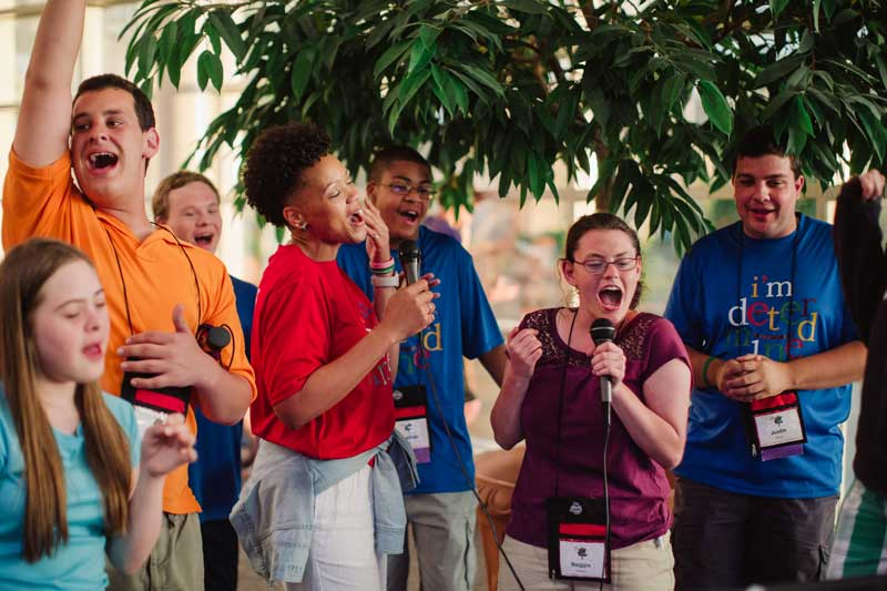 Youth Participants singing karaoke at I'm Determined Youth & Parent Summit