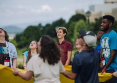 a group of eight youth play a game at an I'm Determined Event