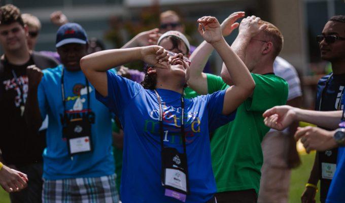 youth in brightly colored shirts celebrate joyfully