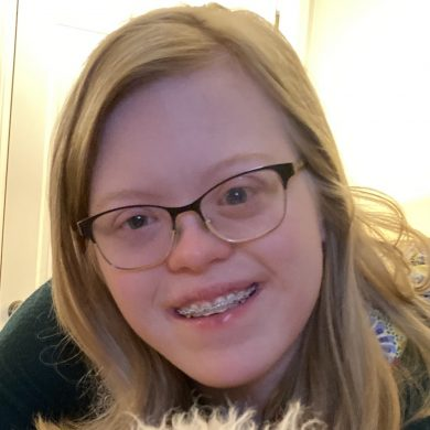 Headshot of Youth Leader, Sydney, female with blond hair and glasses, smiling